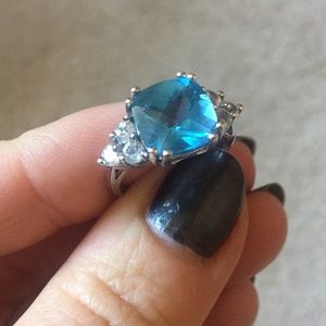 Jewelry - Blue topaz center w/ white sapphire accent ring.